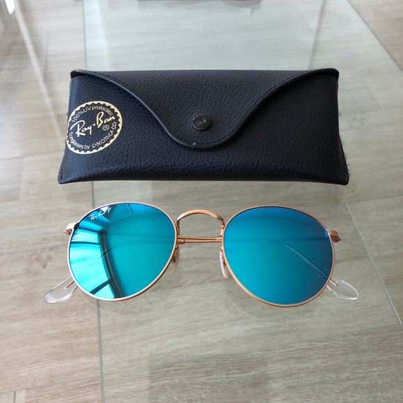 fb05f344a Ray-Ban Round Blue Flash Polarized Sunglasses. M_5b29a7c2a5d7c652decd6575